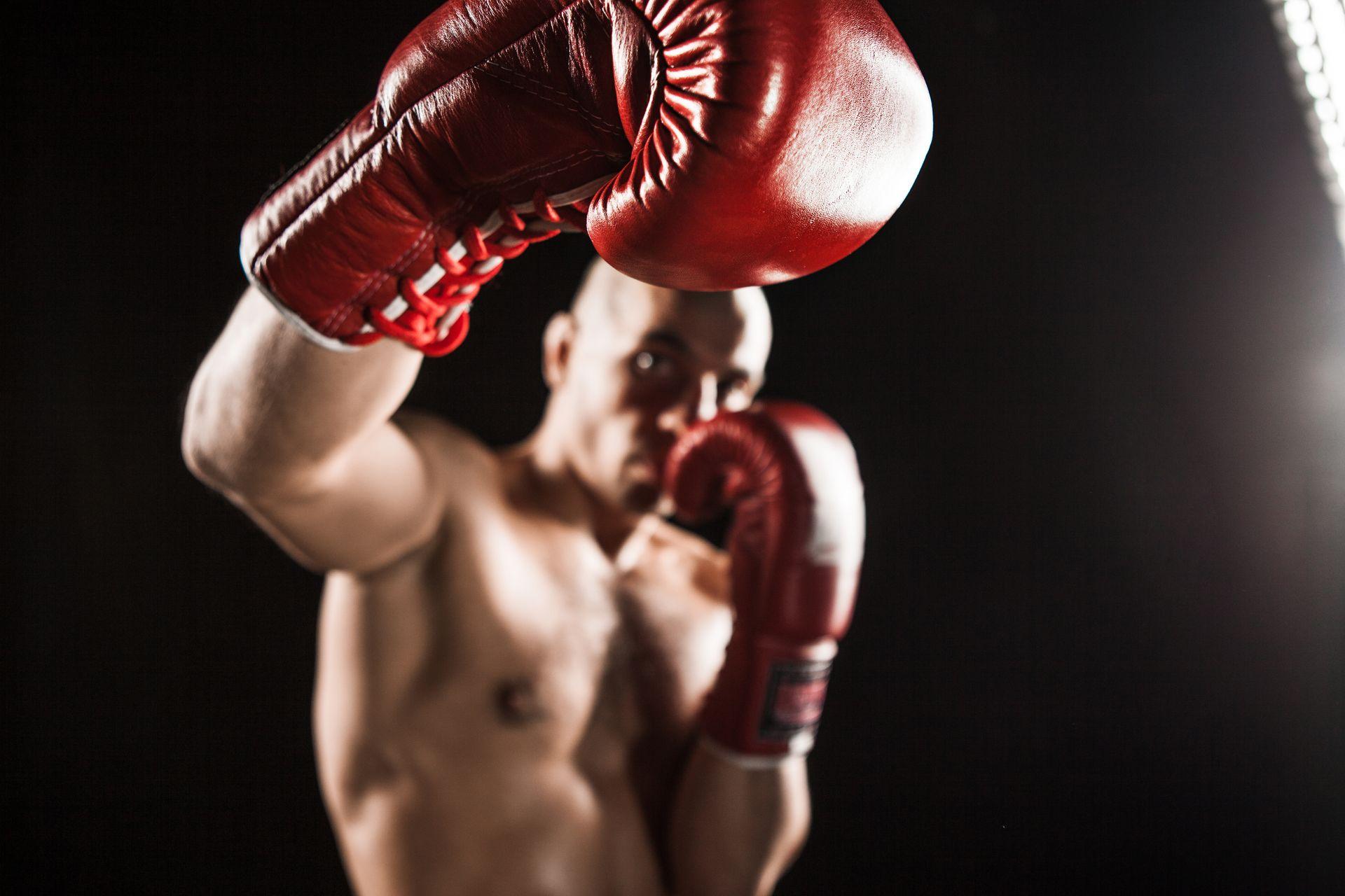 the-young-man-kickboxing-on-black-PQR5ZQ7.jpg